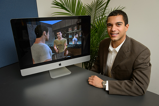 John Christensen, assistant professor of communication, with a health intervention video on Oct. 5, 2012.