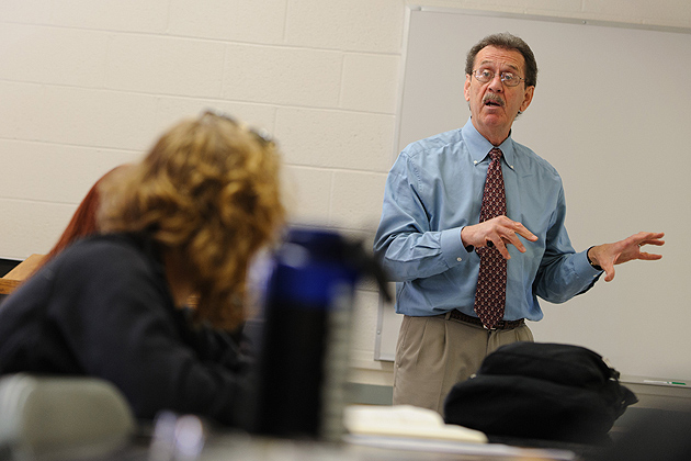 Marcel Dufresne, associate professor of journalism, speaks with students in his investigative reporting class.