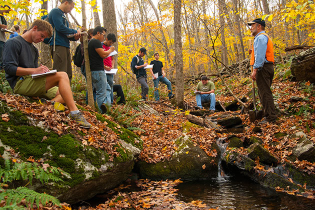 Robert Thorson, professor of ecology and evolutionary biology, teaches an environmental science class along the Fenton River. (Sean Flynn/UConn Photo)