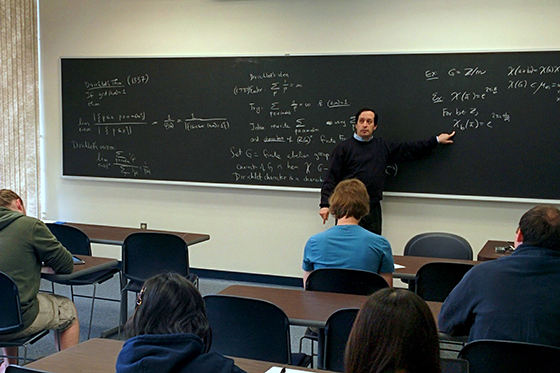 Associate Professor Keith Conrad teaching a math class